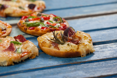 Various delicious italian pizza served on wooden plank