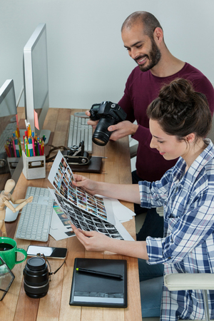 Photographers working at desk in studio