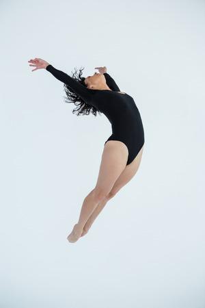 Dancer practicing contemporary dance in dance studio Stock Photo