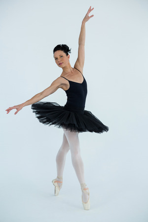 Portrait of ballerina practicing ballet dance in the studio Stock Photo