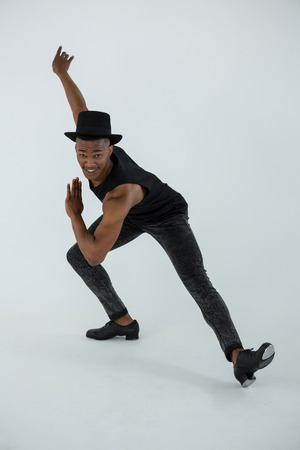 tap dance: Portrait of dancer practising dance in dance studio Stock Photo