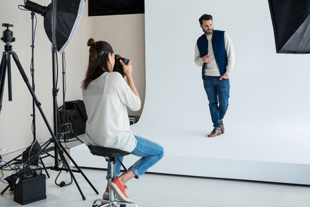 phoning: Male model posing for photographer in studio