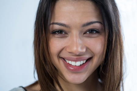 Close-up of smiling woman against white background Stock Photo