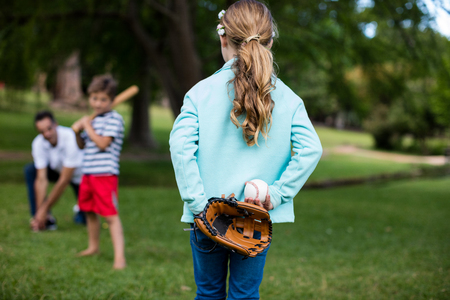 one parent: Happy family playing baseball in the park Stock Photo