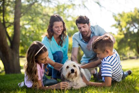 Happy family enjoying in park on sunny a day Stock Photo