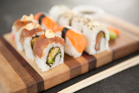 Close-up of assorted sushi set served on wooden board Stock Photo