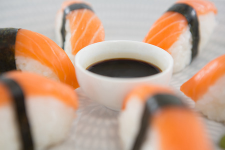 Close-up of sushi served on plate with sauce Stock Photo