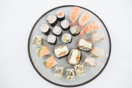 susi: Overhead view of various sushi on plate