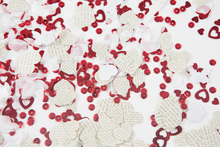 scattered in heart shaped: Close-up of heart-shaped decoration on white background