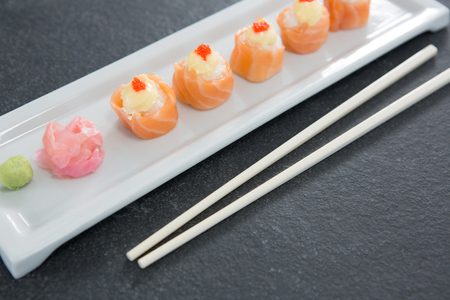 susi: Close-up of sushi on tray with chopsticks
