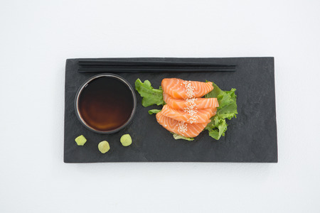susi: Sushi served on tray with chopsticks and sauce
