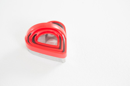 Heart shape cookie cutter in different size on white background