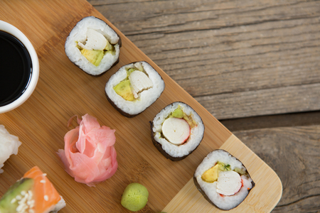 susi: Set of assorted sushi served on tray against wooden background