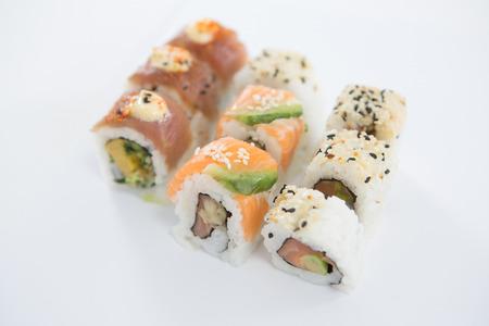 susi: Close-up of uramaki sushi roll on white background Stock Photo