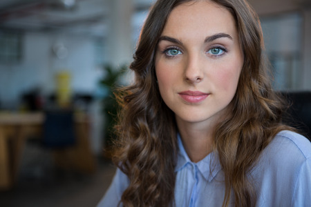 Female businesswoman smiling at camera in office