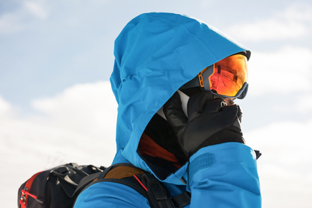 Close-up of skier talking on mobile phone Stock Photo