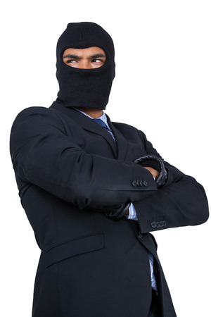 Hacker standing with arms crossed against white background