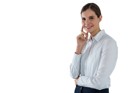 Portrait of smiling businesswoman standing against white background Stock Photo