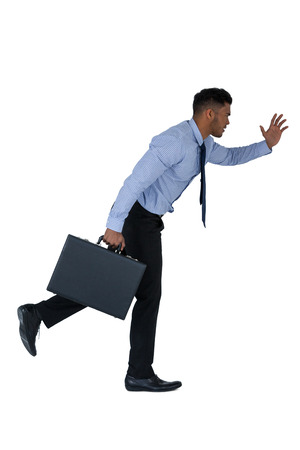 Businessman running with briefcase against white background