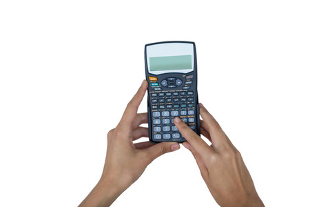 Hand of businesswoman using calculator against white background Stock Photo