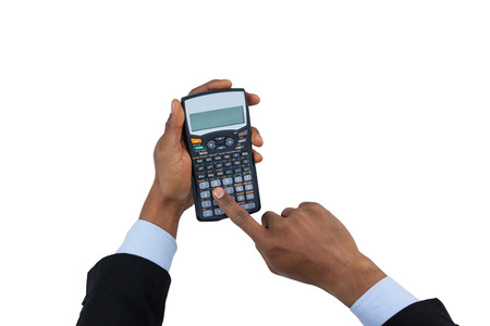 Hand of businessman using calculator against white background Stock Photo
