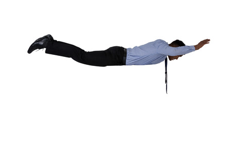 trapped: Businessman flying in air against white background
