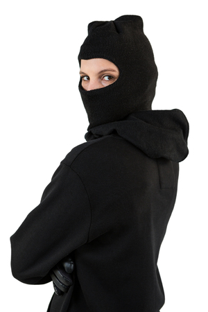 Portrait of female hacker standing with arms crossed against white background