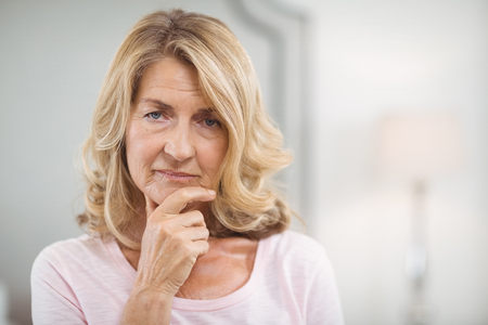 Portrait of thoughtful senior woman at home Stock Photo