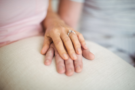 ageing process: Close-up of senior couple holding each others hands Stock Photo