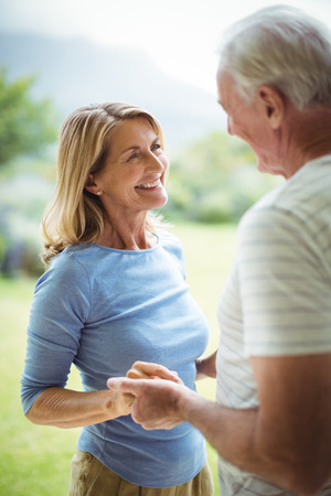 ageing process: Happy senior couple holding each others hands Stock Photo