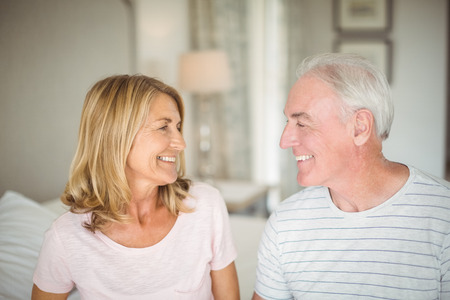 Happy senior couple looking at each other at home Stock Photo