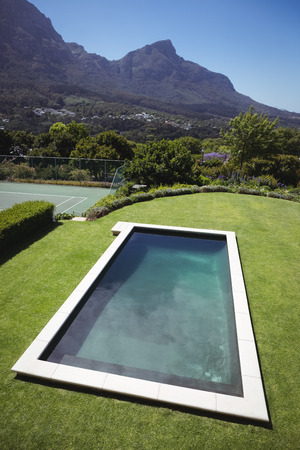 ageing process: Modern and luxurious swimming pool in lawn Stock Photo