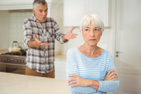 Senior couple quarrelling with each other in kitchen Stock Photo