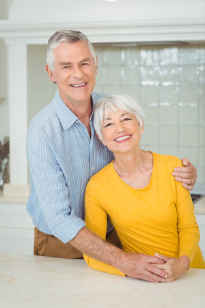 Portrait of happy senior couple in kitchen