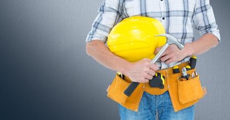 chrome man: Digital composite of Carpenter with hammer against grey background