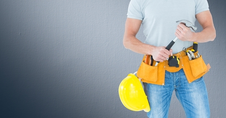 chrome man: Digital composite of Carpenter with hammer against navy background Stock Photo