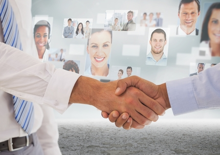 co work: Digital composite of Handshake in front of sky with business people
