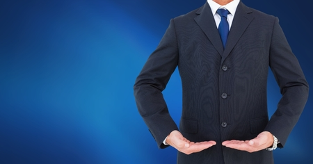 Digital composite of Businessman Torso showing something against neutral dark blue background