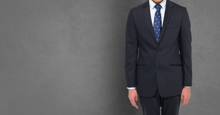 well dressed: Digital composite of Businessman Torso against grey background Stock Photo