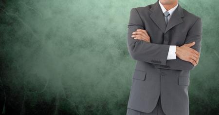 well dressed: Digital composite of Businessman Torso against green background