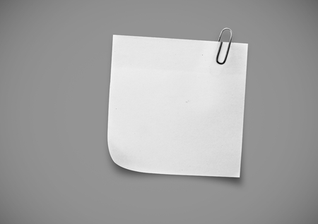 businessteam: Digital composite of white Sticky Note against grey background Stock Photo