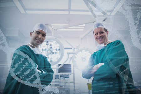 Panoramic view of helix pattern information on device screen against portrait of surgeons standing in operation theater