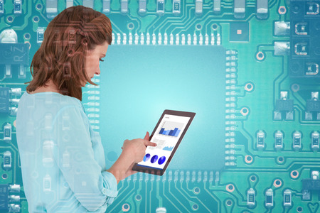 Businesswoman using tablet over white background against green pcb