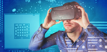 Man using an oculus against micro parts in computer chip Stock Photo