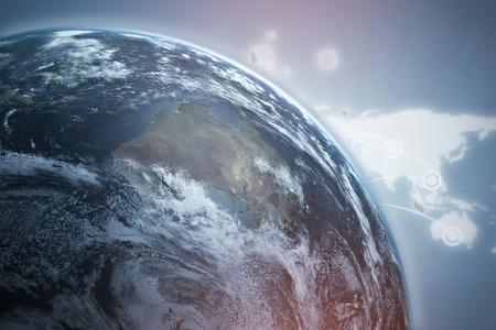3d Graphic image of Earth against grey vignette Reklamní fotografie
