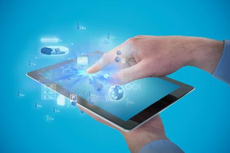 Croped hands of businessman using digital tablet against blue vignette background