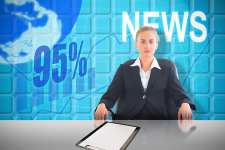 Businesswoman sitting on swivel chair in black suit against blue Stock Photo