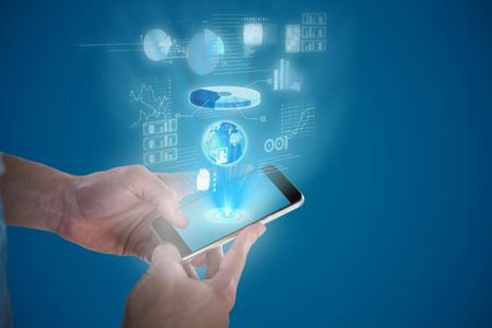 Close-up of man holding smart phone against blue vignette background
