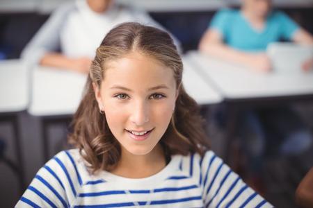 Portrait of smiling schoolgirl in school