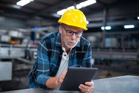 Attentive factory worker using a digital tablet in factory